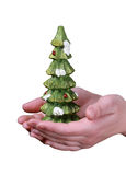 Christmas tree souvenir in hands. Christmas tree souvenir in woman's hands isolated Stock Image