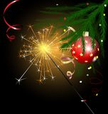 Christmas tree and sparkler Royalty Free Stock Photos