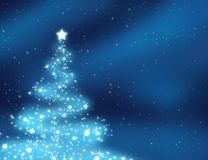 Christmas tree. Sparkling christmas tree on the blue background Stock Image