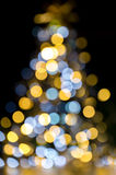 Christmas tree sparkling lights. Golden and blue christmas lights illuminated Background tree stock image