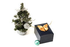 Christmas tree, sphere and gift Stock Images