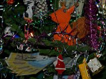 Christmas tree with squirrel. Christmas tree with a toy squirrel, Santa Claus, cone, candy, tinsel and money Stock Photography
