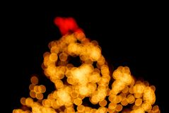Christmas tree with star bokeh light. On black background stock photography