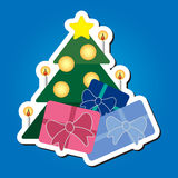 Christmas tree with star and colored gifts. Greeting card or sticker - green Christmas tree with gold star, balls, candles and colored gifts on a blue background Stock Illustration