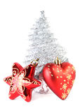 Christmas tree star and heart near Christmas tree Stock Photos