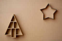 Christmas tree and star shaped gift boxes on cardboard background Royalty Free Stock Photo