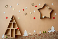 Christmas tree and star shaped gift boxes with decorations on cardboard background Royalty Free Stock Photography