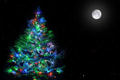 Christmas tree on star sky. Lighten Christmas tree on natural dark star sky with full moon Stock Photography