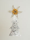 Christmas tree with star on the top. Royalty Free Stock Images