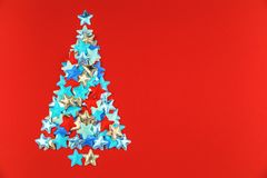 Christmas tree of stars on red background stock photos