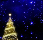 Christmas tree on stars sky background. Royalty Free Stock Photography