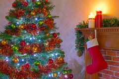 Christmas tree and stocking over the fireplace Stock Photography