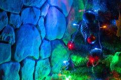 Christmas tree and stone wall Stock Photography