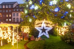 Christmas Tree in Strasbourg, Alsace, France. Christmas Tree and inscription Strasbourg Capital of Christmas, Decorated and illuminated on the Place Kleber in Stock Image