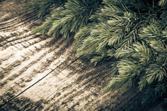 Christmas tree strewn on old wood. Tinted Royalty Free Stock Photo