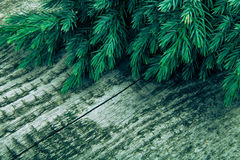 Christmas tree strewn on old wood. Tinted Stock Image