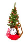 Christmas tree, stump, frame, clock and pillow. Christmas and New Year tree standing on the stump near are golden frame, white clock, red pillows Stock Images