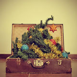 Christmas tree in a suitcase Royalty Free Stock Photos