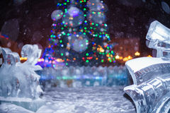 Christmas tree surrounded by Ice sculpture during snowy night Stock Photo