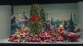 Christmas tree surrounded by a variety of goods in a shop window Royalty Free Stock Photo