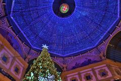 Christmas tree by Swarovski and the Vittorio Emanuele Gallery decorated roof in Milan. Stock Images