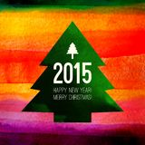 Christmas Tree symbol. Colorful watercolor. Painting with 2015 label. Greeting card with Happy New Year and Merry Christmas typing. Xmas background can be used stock illustration
