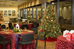 Christmas tree and table. Table and christmas tree prepared for a xmas dinner. Gifts can be see on a red table Royalty Free Stock Photo