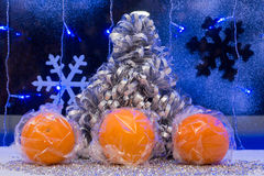 Christmas tree, tangerine and decoration. wallpaper. Stock Photo