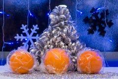 Christmas tree, tangerine and decoration. wallpaper. Stock Photo