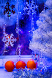 Christmas tree, tangerine wallpaper. Stock Photos