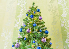 Christmas tree with tinsel and balls Royalty Free Stock Image