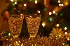 Christmas tree tinsel lights glasses Royalty Free Stock Image