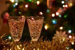 Christmas tree tinsel lights glasses Royalty Free Stock Photos