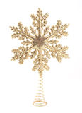 Christmas Tree Topper. A metallic gold star Christmas tree topper with colored sparkles royalty free stock photography