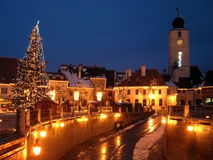 Christmas tree town street houses tower. Christmas tree in town market with houses and tower architecture medieval square Sibiu Romania Transylvania Royalty Free Stock Image