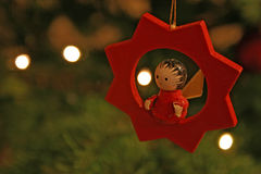 Christmas tree toy. Of a man in a star dangling in the tree Stock Images