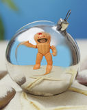 Christmas tree toy. Toy astronaut reflected in Christmas decorations Royalty Free Stock Photo