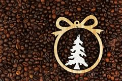 Christmas tree toy on the background of coffee beans. For the New Year holiday Stock Photo
