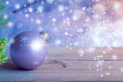 Christmas tree toy ball closeup on wooden table and blur background, new year and Christmas background. Christmas tree toy ball closeup on wooden table and blur royalty free stock image