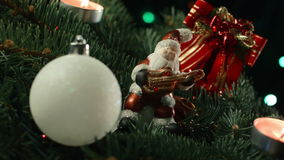 Christmas tree with toy balls and Santa stock footage