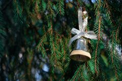 Christmas tree toy bell. Christmas tree toy bell on a green branch. Old Russian toy Stock Photos