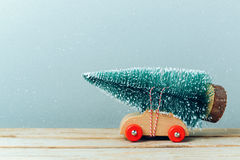 Christmas tree on toy car. Christmas holiday celebration concept. Christmas tree on toy car. Christmas holiday celebration royalty free stock image