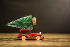 Christmas tree on toy car. Christmas holiday concept. Christmas tree on toy car. Christmas holiday celebration concept royalty free stock photo