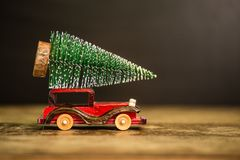 Christmas tree on toy car. Christmas holiday concept. Christmas tree on toy car. Christmas holiday celebration concept royalty free stock images
