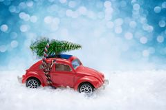 Christmas tree on toy car. Christmas holiday celebration concept royalty free stock photography