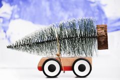 Christmas tree on toy car close up. Funny Christmas holiday celebration. Concept royalty free stock images