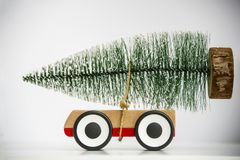Christmas tree on toy car close up. Funny Christmas holiday celebration. Concept royalty free stock photos