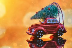 Christmas tree on toy car. Christmas holiday celebration concept.  royalty free stock photo