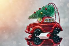 Christmas tree on toy car. Christmas holiday celebration concept.  royalty free stock image