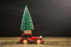 Christmas tree on toy car. Christmas holiday concept. Christmas tree on toy car. Christmas holiday celebration concept royalty free stock image